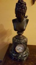 orologio con base marmo e figura di donna in bronzo