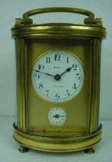 """Horloge de table """"officier"""" avec de l'argent ovale sonnerie d'alarme."""