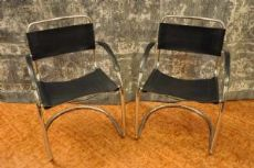 Four leather and steel chairs