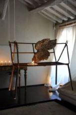 Altalena in ferro con seduta traforata in patina originale.  Italia. 1950  Alt.62cm Larg.71cm Prof.40cm