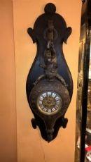Orologio con putto in antimonio