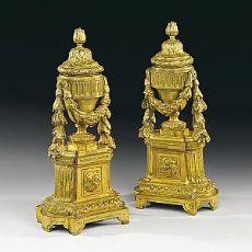 Coppia di alari in bronzo dorato