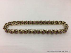 Bracciale in oro primi 900 con 33 fiori con rubini
