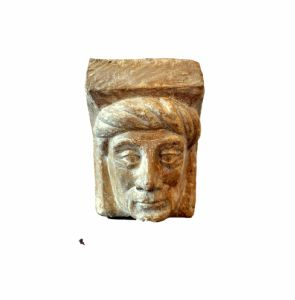 A gothic limestone fragment showing a man's head.Flemish c.1450