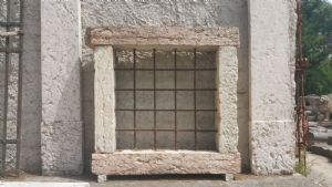 Antique marble window with railing""