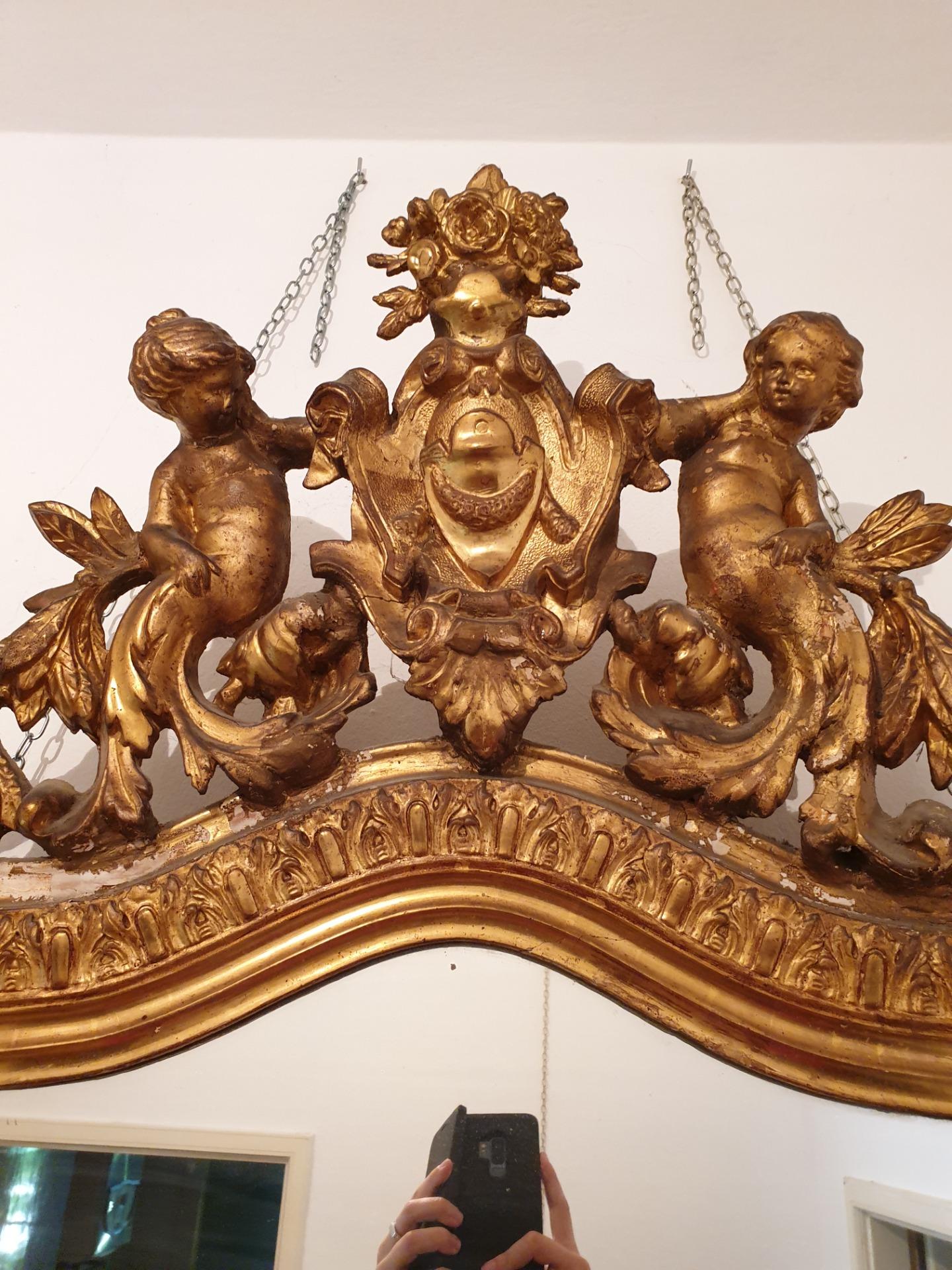 thumb2|Specchiera in legno dorato