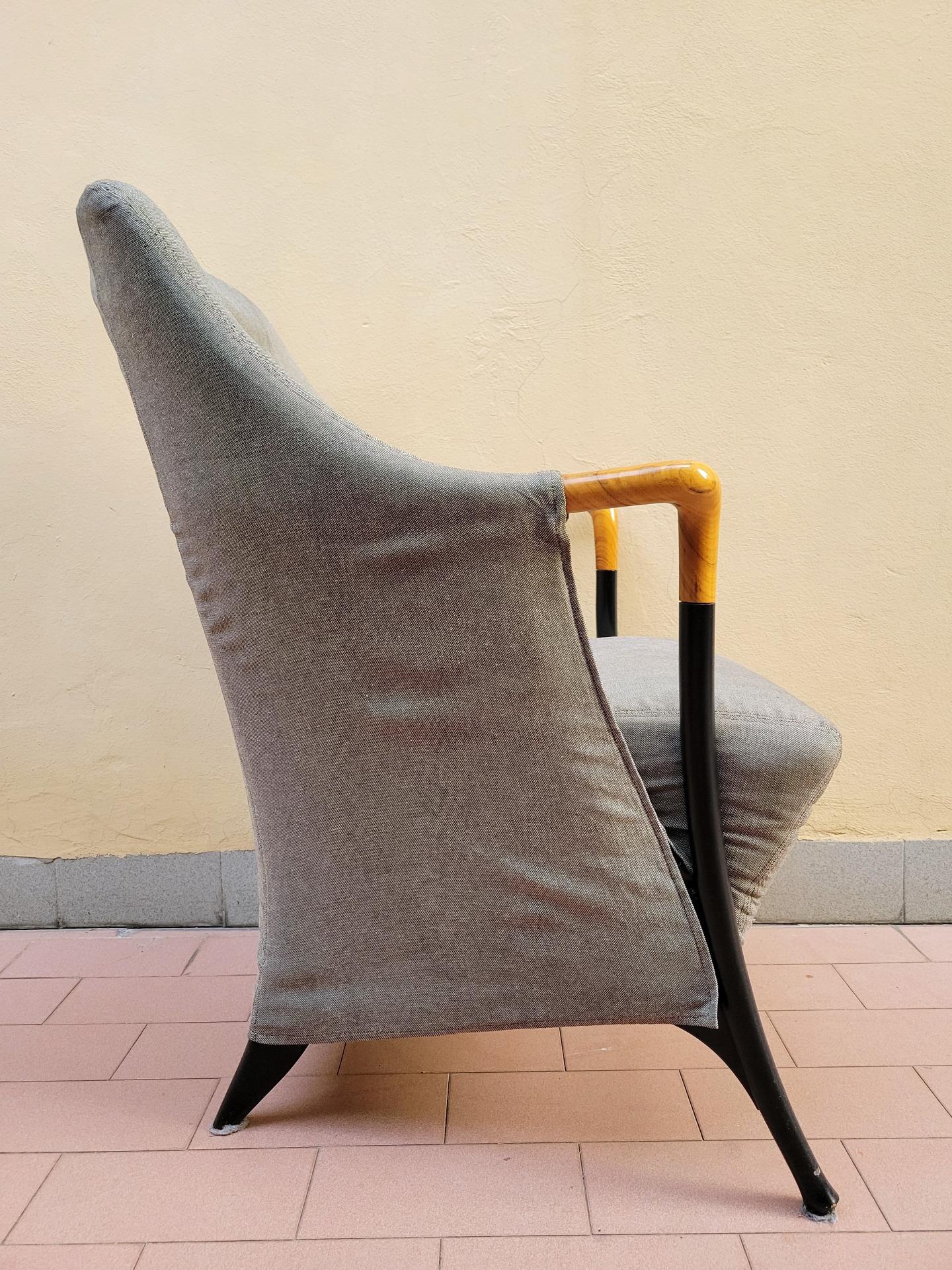 thumb2|Poltrona Progetti em tecido verde - Giorgetti