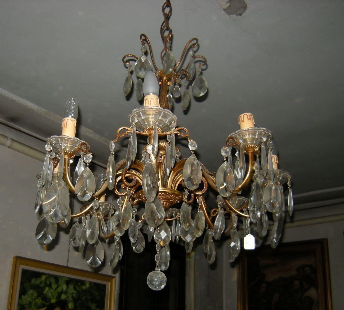 lampadari in bronzo : Lampadario 8 luci, con bracci e fusto in bronzo dorato, con prismi e ...