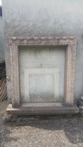 Antique marble window decorated with braid and pink""