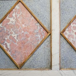 Wooden panel with fake marble decoration""
