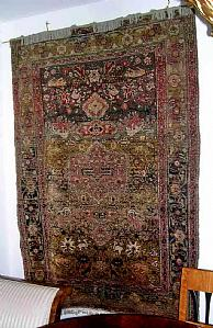 Charming old turkish carpet with images of animals and fairs.