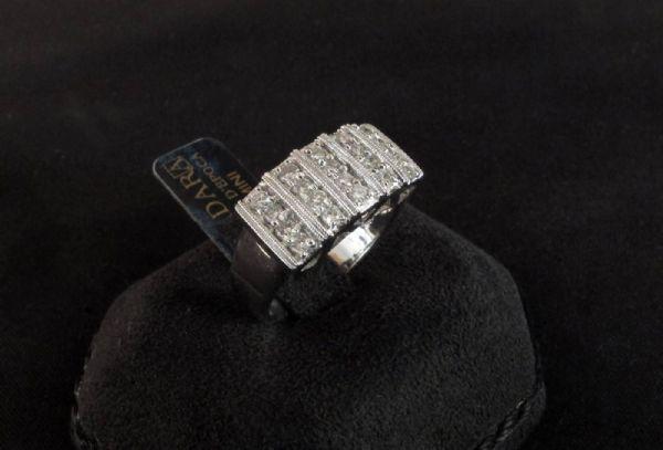 Anello fascia  con  Diamanti  per  0.80  ct.