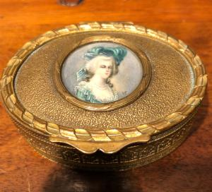 Oval brass box with ivory medallion-miniature depicting a lady. France.
