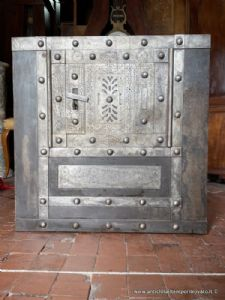 Antique Italian safe from the 19th century with engravings and studs
