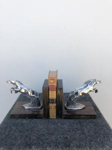Pair of metal and wood bookends depicting art-d'eco style horses.