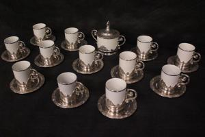 Tea set in porcelain and silver metal