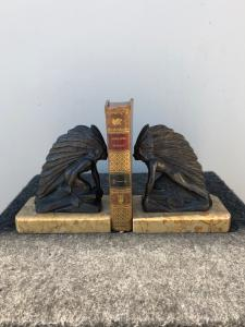 Pair of metal and marble bookends depicting two Red Indians.