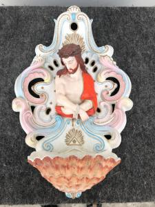 Pierced bisque porcelain stoup with rocaille motifs and half-length figure of Christ tied.