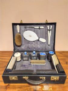 Travel set with leather case signed Alexandrine, Champs-Elisées France