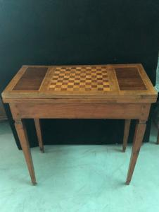 Game table in cherry wood inlaid with other woods (rosewood and more).