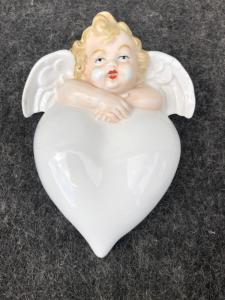 Porcelain stoup in the shape of a heart with a puttino.Germania.