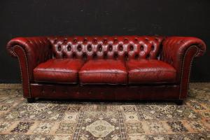 Original Chesterfield three-seater sofa in burgundy red leather