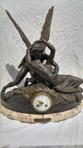 "Antimony table clock and marble base depicting ""Amour et Psyche"""