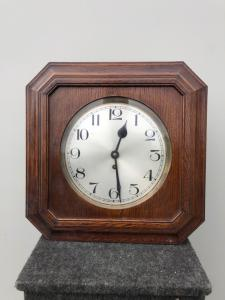 Wall clock in oak wood. Deco period.