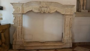Antique stone fireplace with coat of arms
