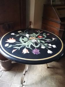 round table in inlaid marble
