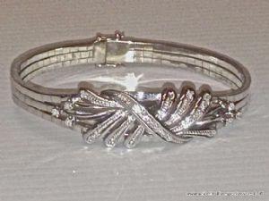 Bracciale in oro bianco con 27 piccoli diamanti (ct.0,60)