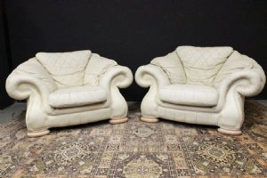 Pair of original English Chesterfield club armchairs in creamy white leather