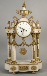Napoleon III clock in white marble with rich application of gilded bronzes - France, second half of the 19th century