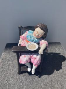 Tobacco box depicting a little girl asleep on the high chair. France.