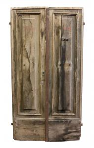 Antique wooden door with iron reinforcement. Period 1800.