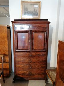 Mahogany cabinet with drawers and doors