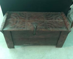 Small chest in walnut lectern with engraved geometric decorations. Friuli.