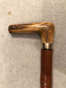 Animated stick with deer horn knob and awl to puncture grain bags. Bamboo cane.