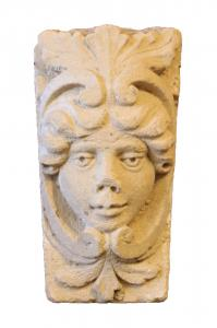 Antique stone mask. Period 1700s.