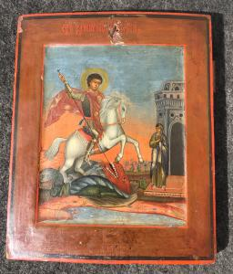 Icon on panel depicting Saint George and the dragon.Russia.