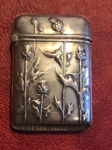 Silver matchbox with art nouveau thistle floral decoration.