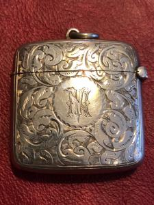 Silver matchbox with rocaille decoration with NV initials England.