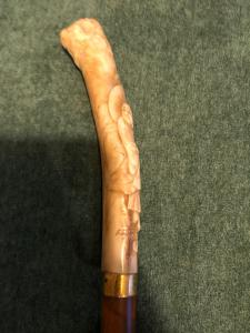 Stick with ivory knob depicting a Japanese character. Barrel in rattan.