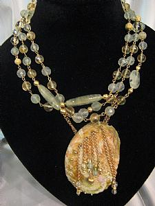 Chanel necklace with central shell and earrings parure