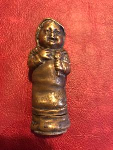 Brass matchbox in the shape of an infant child.