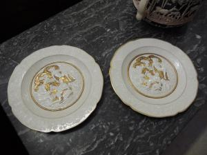 two white porcelain plates with golden reliefs, diameter 26 cm, Capodimonte