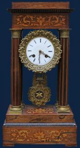 XIX century, Clock Various wooden essences and gilded bronze, alt. 51 cm