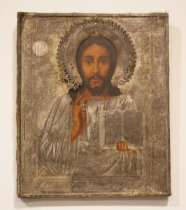 Ancient Russian icon from 1800 depicting Jesus with engraved silver cover