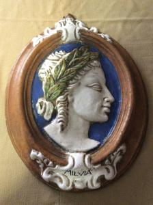 Ornamental medallion in glazed terracotta, Tuscan manufacture of the early twentieth century