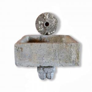 Ancient stone fountain. Period 1800.